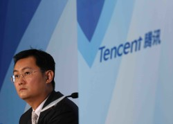 Tencent Chairman & Chief Executive Officer Pony Ma attends a news conference announcing the company's results in Hong Kong March 18, 2015. Tencent Holdings Ltd , China's biggest social network and online entertainment firm, posted a 51 percent gain in fourth-quarter net income, missing estimates, as sharing and content costs took a bite out of healthy revenue growth.   REUTERS/Bobby Yip