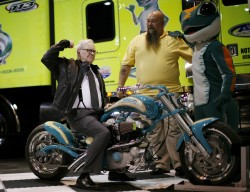 Billionaire financier and Berkshire Hathaway Chief Executive Warren Buffett poses on a motorcycle during the Berkshire Hathaway Annual Shareholders meeting in Omaha, Nebraska in this May 3, 2008 file photo. Berkshire Hathaway Inc agreed to take over unlisted German motorbike accessories retailer Detlev Louis Motorrad-Vertriebs GmbH, the seller's law first said February 20, 2015. REUTERS/Carlos Barria/files (UNITED STATES - Tags: BUSINESS PROFILE)