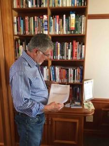 Jannie Mouton examining his books