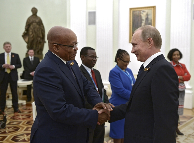Russian President Vladimir Putin (R) shakes hands with South African President Jacob Zuma during their meeting at the Kremlin in Moscow, Russia, May 9, 2015. REUTERS/Alexei Nikolsky/RIA Novosti/Kremlin