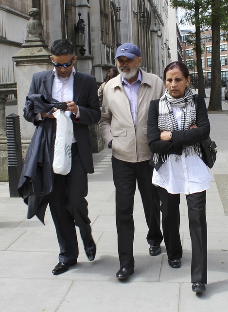 The family of Navinder Sarao leave the High Court in London, Britain May 20, 2015. Navinder Sarao remains in custody after his appeal to have his bail conditions relaxed was turned down at the High Court. Sarao was arrested by British police on a U.S. extradition warrant a month ago after being charged with wire fraud, commodities fraud, and market manipulation by the U.S. Justice Department. REUTERS/Sophie Wedgwood