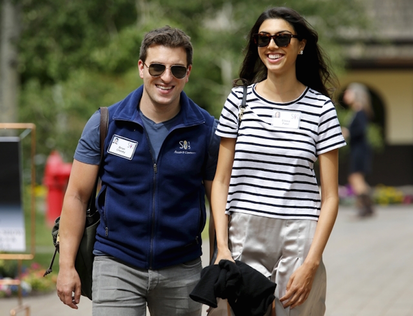 Brian Chesky, cofounder and the CEO of Airbnb, walks with Elissa Patel during the first day of the annual Allen and Co. media conference in Sun Valley, Idaho July 8, 2015. REUTERS/Mike Blake