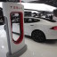 A Tesla S electric car and a charging station are displayed during the press preview day of the North American International Auto Show in Detroit, Michigan, in this file photo taken January 14, 2014. The car scored 103 out of a possible 100 in a test by a major US magazine. REUTERS/Rebecca Cook