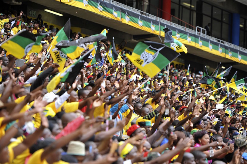 Supporters of South Africa's ruling ANC party cheer as South Africa's President and party leader Jacob Zuma (not seen) arrives for the launch of the party's election manifesto at the Mbombela stadium in Nelspruit, January 11, 2014. REUTERS/Ihsaan Haffejee (SOUTH AFRICA - Tags: POLITICS ELECTIONS)