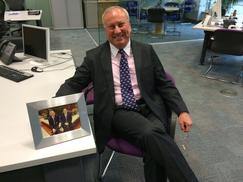 Bernard Kantor in his London office showing us his favourite picture - sharing a joke with co-founder Stephen Koseff