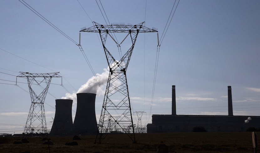 Electricity pylons are seen near Arnot Power Station's cooling towers, east of Middelburg in Mpumalanga province, September 8 2015. REUTERS/Siphiwe Sibeko