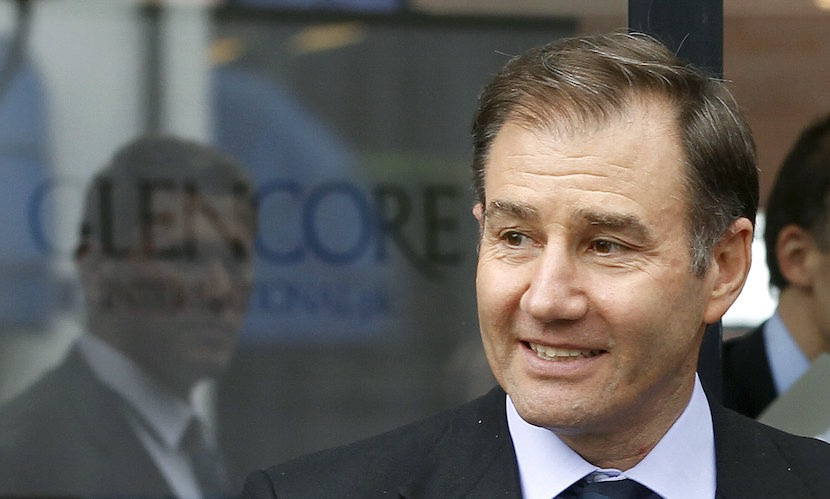 Glencore CEO Ivan Glasenberg smiles as he leaves after the company's annual shareholder meeting in the Swiss town of Zug in this May 9, 2012 file photo. Shares in mining and trading company Glencore fell almost 30 percent and closed at a record low on Monday over concerns it is not doing enough to cut its debt to withstand a prolonged fall in global metals prices.About 3.5 billion pounds ($5.33 billion) in market value was wiped off the Swiss-based firm, whose $10 billion share offering in 2011 turned its managers into billionaire shareholders but left it saddled with debt - a growing problem as commodity prices fell. REUTERS/Arnd Wiegmann/Files