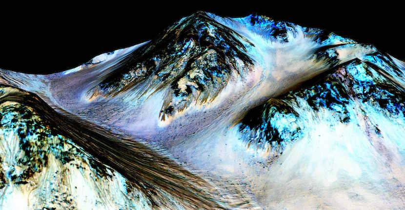Dark, narrow, 100 meter-long streaks on Mars inferred to have been formed by contemporary flowing water are seen in an image produced by NASA, the Jet Propulsion Laboratory (JPL) and the University of Arizona. Scientists have found the first evidence that briny water may flow on the surface of Mars during the planet's summer months, a paper published on Monday showed. NASA/JPL/University of Arizona/Handout THIS IMAGE HAS BEEN SUPPLIED BY A THIRD PARTY. IT IS DISTRIBUTED, EXACTLY AS RECEIVED BY REUTERS, AS A SERVICE TO CLIENTS. FOR EDITORIAL USE ONLY. NOT FOR SALE FOR MARKETING OR ADVERTISING CAMPAIGNS