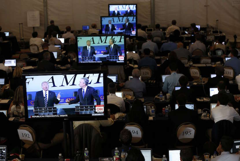 Members of the news media watch on television monitors in the media center as Republican U.S. presidential candidates businessman Donald Trump and former Florida Governor Jeb Bush debate during the second official Republican presidential candidates debate of the 2016 U.S. presidential campaign at the Ronald Reagan Presidential Library in Simi Valley, California, September 16, 2015. REUTERS/Mario Anzuoni
