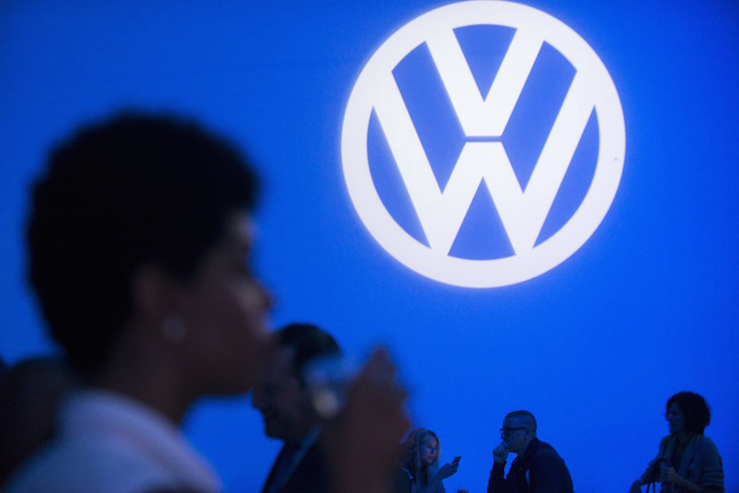 """Attendees take part in the 2016 Volkswagen Passat reveal in the Brooklyn borough of New York September 21, 2015. Volkswagen AG's U.S. head on Monday said he was confident the German automaker would restore customer confidence after it """"totally screwed up"""" by rigging emissions tests of diesel-powered vehicles in the United States. Michael Horn vowed to make amends at a lavish event in New York to promote the 2016 Passat where the carmaker doled out German beer, pretzels and """"cheddary ale fondue"""" to dealers and the media, before a performance of rockstar Lenny Kravitz. REUTERS/Darren Ornitz"""