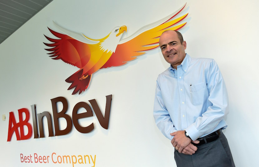 Carlos Brito, chief executive of Anheuser-Busch InBev, poses for photographer prior to a news conference in Leuven in this file photo from February 26, 2015. Anheuser-Busch InBev has approached rival SABMiller about a takeover that would form a brewing colossus which makes around a third of the beer consumed globally. REUTERS/Eric Vidal/Files
