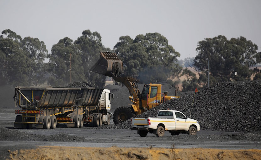 Coal is loaded onto a truck at the Woestalleen colliery near Middleburg in Mpumalanga province, in this September 8, 2015 file photo. Shares in mining and trading company Glencore fell almost 30 percent and closed at a record low on Monday over concerns it is not doing enough to cut its debt to withstand a prolonged fall in global metals prices. About 3.5 billion pounds ($5.33 billion) in market value was wiped off the Swiss-based firm, whose $10 billion share offering in 2011 turned its managers into billionaire shareholders but left it saddled with debt - a growing problem as commodity prices fell. REUTERS/Siphiwe Sibeko/Files