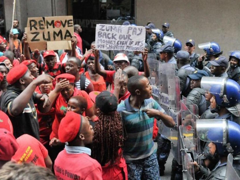 Protesters of the Economic Freedom Fighters confront riot police Reuters