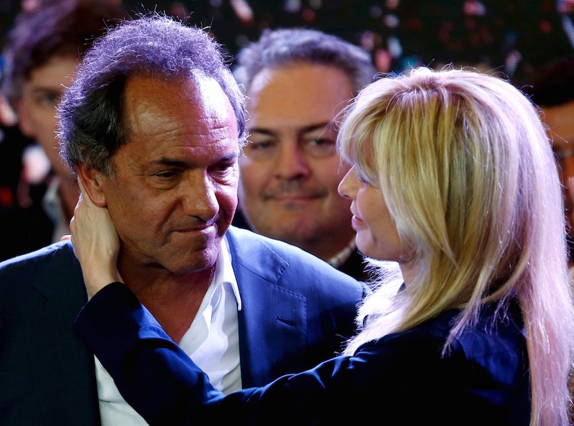 Argentina's ruling party presidential candidate Daniel Scioli is embraced by his wife Karina Rabolini after he acknowledged his defeat in the run-off presidential election in Buenos Aires November 22, 2015. Scioli conceded defeat in Sunday's presidential election after calling his center-right challenger Mauricio Macri to congratulate him. REUTERS/Marcos Brindicci