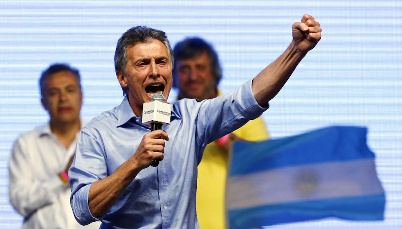 Mauricio Macri, presidential candidate of the Cambiemos (Let's Change) coalition, gestures to his supporters after the presidential election in Buenos Aires, Argentina, November 22, 2015. Conservative opposition candidate Macri comfortably won Argentina's presidential election on Sunday after promising business-friendly reforms to spur investment in the struggling economy. REUTERS/Ivan Alvarado TPX IMAGES OF THE DAY