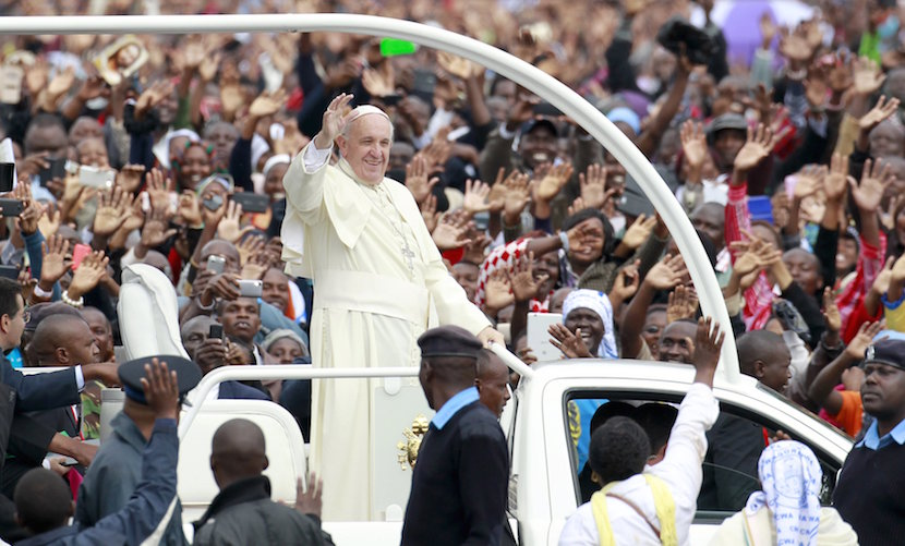 Pope Francis waves to faithful while riding in an open truck as he arrives for a Papal mass in Kenya's capital Nairobi, November 26, 2015. In actions and words on his first tour of the world's poorest continent, Pope Francis has sent a message to African leaders that they could do with less pomp and a bit more humility. Francis, who has spurned many of the institutional perks of the Vatican, shunned the armoured cars with tinted glass driven by President Uhuru Kenyatta and his entourage. REUTERS/Thomas Mukoya