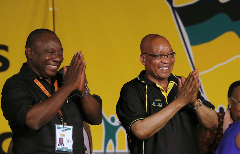 South Africa's President Jacob Zuma (C) celebrates his re-election as party President alongside his deputy Cyril Ramaphosa (L) at the National Conference of the ruling African National Congress (ANC) in Bloemfontein, in this December 18, 2012 file photo. A hotly contested party vote earlier this month has deepened divisions within South Africa's ruling African National Congress and stirred debate over President Jacob Zuma's successor. His ex-wife, African Union head Nkosazana Dlamini-Zuma, has just edged ahead of the front-runner, deputy president Cyril Ramaphosa, after a vote in the ANC's Zulu heartland swung in her favour, exposing rifts in the ruling alliance with the South African Communist Party (SACP) and trade union group, COSATU. Zuma, who is expected to stay president until a 2019 election and is likely to be influential behind the scenes in picking a new ANC leader at a conference in 2017, is expected to support Dlamini-Zuma. REUTERS/Mike Hutchings/Files