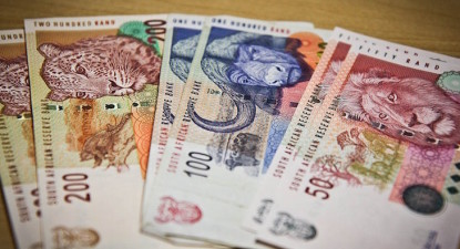 Despite late selloff rand set for biggest Sept gain of currencies tracked by Bloomberg