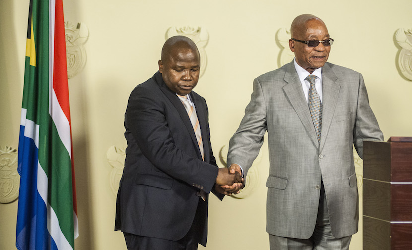 David van Rooyen, South Africa's incoming finance minister, left, shakes hands with Jacob Zuma, South Africa's president, during his swearing in ceremony at the Union Buildings in Pretoria, South Africa, on Thursday, Dec. 10, 2015. The rand fell for a sixth day in the longest streak of losses since November 2013, stocks slid and bond prices tumbled the most on record after South African President Jacob Zuma fired Finance Minister Nhlanhla Nene and replaced him with a little-known lawmaker. Photographer: Waldo Swiegers/Bloomberg *** Local Caption *** David van Rooyen; Jacob Zuma