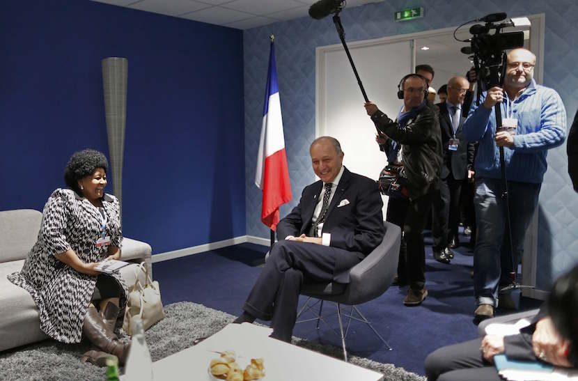 South Africa's Minister of Environmental Affairs Edna Molewa (L) listens to French Foreign Affairs Minister Laurent Fabius, President-designate of COP2, during a meeting at the World Climate Change Conference 2015 (COP21) at Le Bourget, near Paris, France, December 8, 2015. REUTERS/Jacky Naegelen