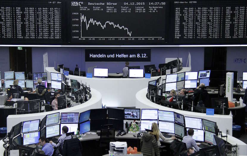 Traders are pictured at their desks in front of the DAX board at the stock exchange in Frankfurt, Germany. REUTERS/Staff/Remote.