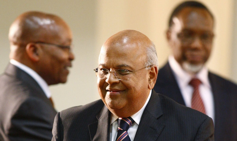 Pravin Gordhan (C) smiles as he walks past South Africa's President Jacob Zuma (L) at the presidential guest house in Pretoria in this May 11, 2009 file photo. Zuma has appointed Gordhan finance minister, a statement said on December 13, 2015, handing South Africa its third finance chief in a week and giving way to a wave of criticism of his last choice and selling frenzy in the markets. REUTERS/Siphiwe Sibeko/Files