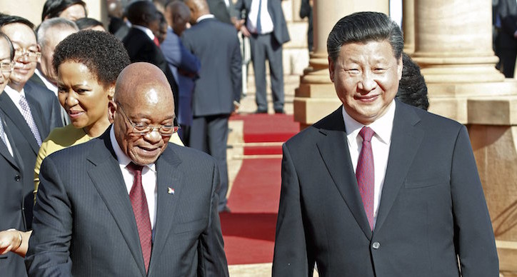Chinese President Xi Jinping walks with South African President Jacob Zuma  upon his arrival at the Union Buildings in Pretoria , December 2, 2015. REUTERS/Sydney Seshibedi