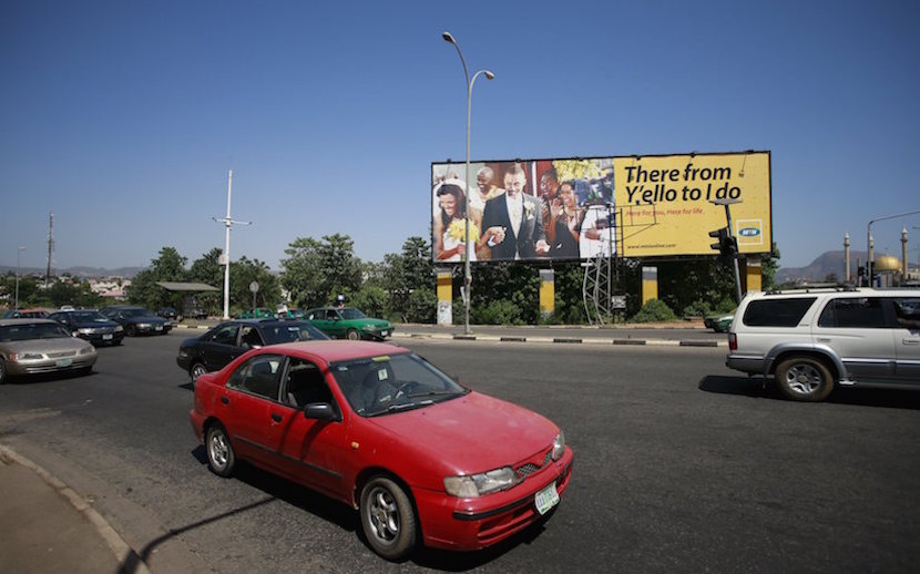 Vehicles stop at a traffic junction by an MTN billboard in central business district Abuja, Nigeria November 17, 2015. REUTERS/Afolabi Sotunde
