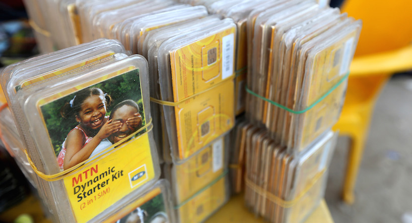 Packets of MTN sim cards sit for sale at a roadside kiosk in Lagos, Nigeria. Africa's largest wireless operator remains in negotiations with Nigerian regulators over a $5.2 billion fine for failing to comply with an order to disconnect customers with unregistered phone cards, according to a person familiar with the matter. Photographer: George Osodi/Bloomberg