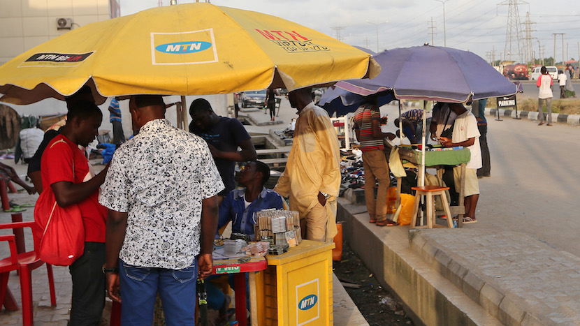 File photo: Customers register their MTN Group mobile phone sim cards at a roadside kiosk in Lagos, Nigeria, on Saturday, Oct. 31, 2015. Photographer: George Osodi/Bloomberg