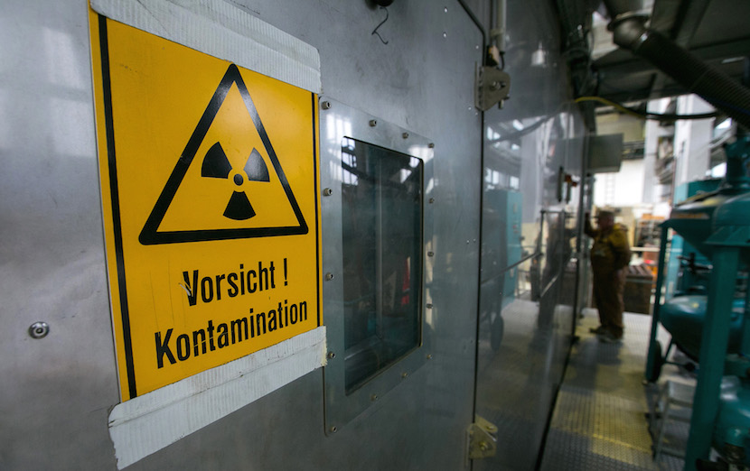 A radioactive contamination warning sign sits on display in the dry abrasive blasting facility during decommissioning operations at Lubmin nuclear power plant in Greifswald, German. Chancellor Angela Merkel's cabinet backed legislation to make German nuclear-power plant owners pay all shutdown and cleanup costs. Photographer: Krisztian Bocsi/Bloomberg