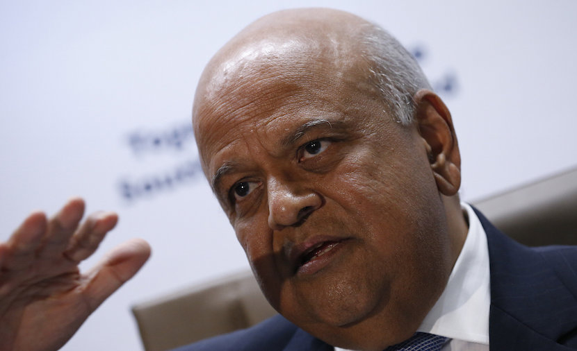 South Africa's Finance Minister, Pravin Gordhan gestures during a media briefing after he was reappointed to the position on Sunday night by President Jacob Zuma in Pretoria, South Africa December 14, 2015. REUTERS/Siphiwe Sibeko