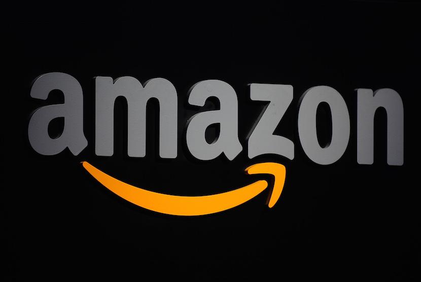 The Amazon logo is seen on a podium