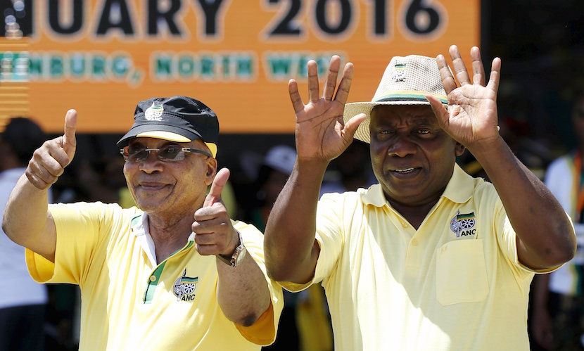South Africa's President Jacob Zuma (L), who is also the president of the ruling party, the African National Congress (ANC), gestures next to his Deputy President Cyril Ramaphosa during the party's 104th anniversary celebrations in Rustenburg January 9, 2016. REUTERS/Siphiwe Sibeko