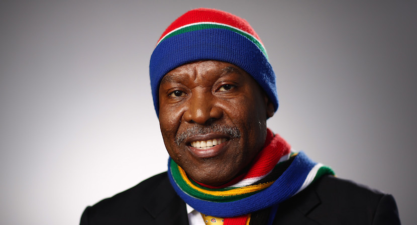 Lesetja Kganyago, governor of South Africa's reserve bank, poses for a photograph wearing a South African coloured matching woollen hat and scarf in Davos, Switzerland. Photographer: Simon Dawson/Bloomberg