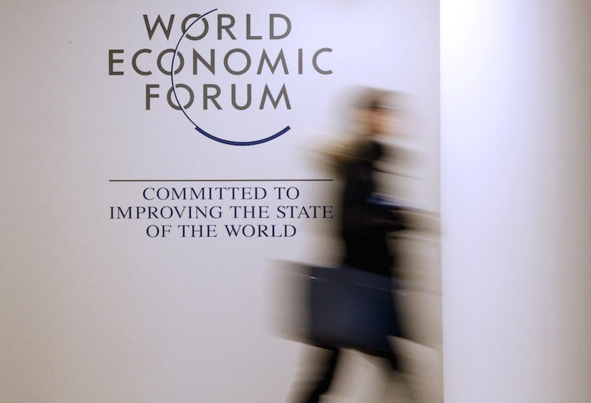 A person passes by a logo of the World Economic Forum (WEF) in the congress centre ahead of the Annual Meeting 2016 of the WEF in Davos, Switzerland, January 18, 2016. REUTERS/Ruben Sprich