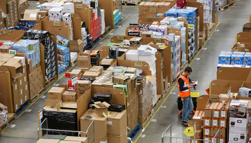 An employee checks an order at the Amazon.com fulfillment center in Hemel Hempstead, U.K. Chris Ratcliffe/Bloomberg