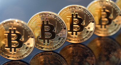 "Bloomberg View: Banking's rocky future as China, UK mull official ""Bitcoin"""