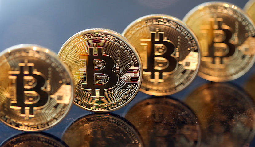 A collection of bitcoins stand in this arranged photograph in London, U.K., on Friday, Jan. 29, 2016. The International Monetary Fund extolled the potential benefits of virtual currencies and said they warrant a more nuanced regulatory approach, at a time when the future of bitcoin, the most well-known example, is in doubt's. Bitcoin traded at about $379 on Jan. 20, about a third of its peak in 2013. Photographer: Chris Ratcliffe/Bloomberg
