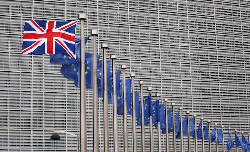 A Union Jack flag flutters next to European Union flags ahead of a visit from Britain's Prime Minister David Cameron at the EU Commission headquarters in Brussels, Belgium, January 29, 2016. REUTERS/Francois Lenoir