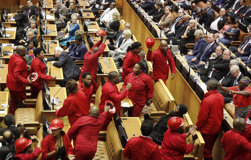 Members of the opposition Economic Freedom Fighters (EFF) party leave the parliamentary chamber as South Africa's President Jacob Zuma delivers his State of the Nation address in Cape Town, February 11, 2016. REUTERS/Schalk van Zuydam