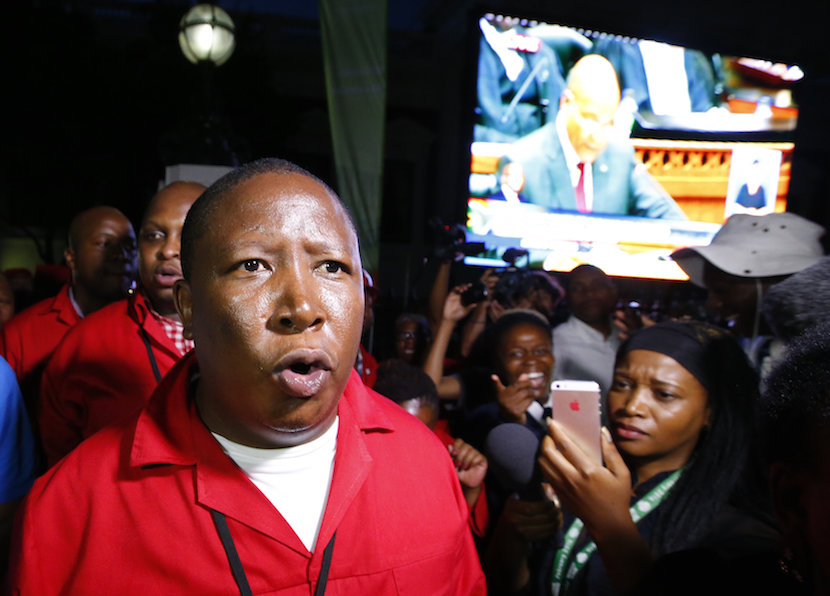 Economic Freedom Fighters (EFF) leader Julius Malema leaves the parliament after being ordered to do so during President Jacob Zuma's State of the Nation address in Cape Town, February 11, 2016. REUTERS/Mike Hutchings
