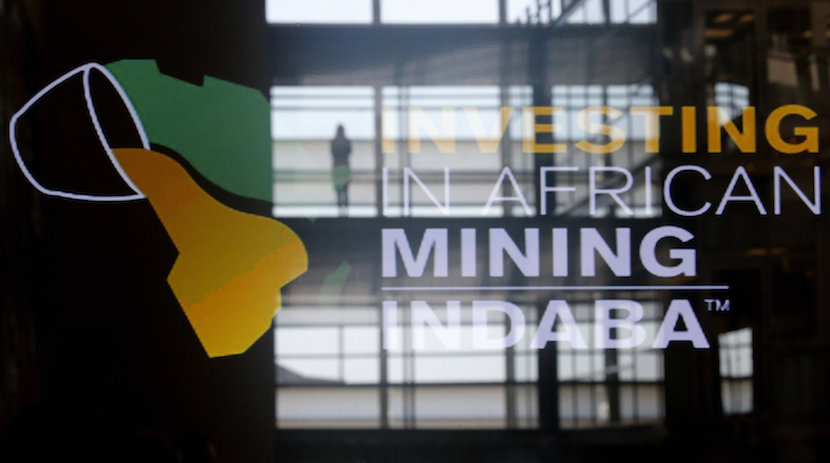 Delegates are reflected in a sign at the Investing in African Mining Inbaba in Cape Town, South Africa, February 8, 2016. REUTERS/Mike Hutchings
