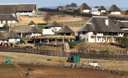 A general view of the Nkandla home (behind the huts) of South Africa's President Jacob Zuma in Nkandla in this August 2, 2012 file photo. REUTERS/Rogan Ward