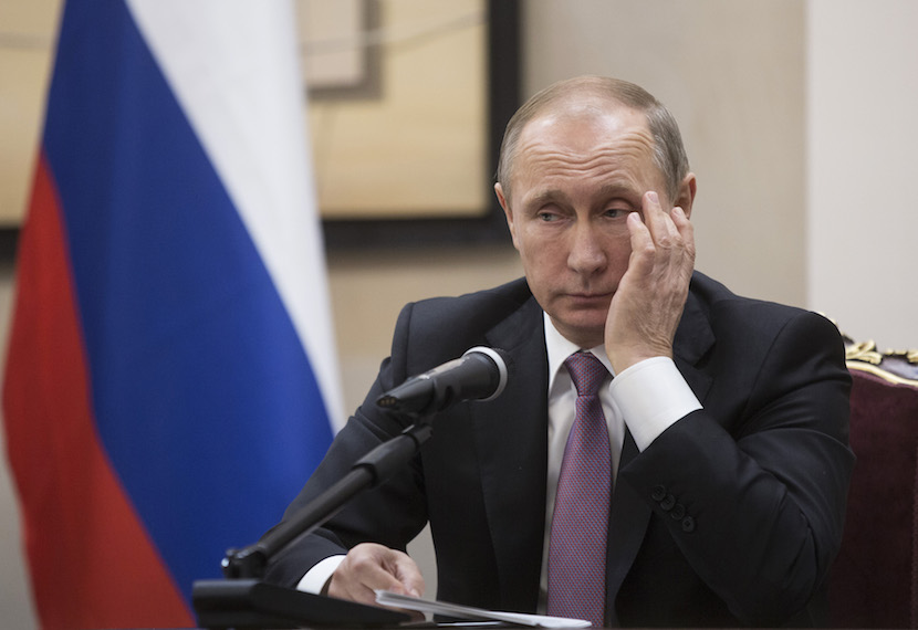 Vladimir Putin, Russia's president, pauses during a news conference alongside Hassan Rouhani, Iran's president, not pictured, at the Gas Exporting Countries Forum (GECF) summit in Tehran, Iran, 2015. The talks between Putin, on his first visit to Iran since 2007, and Iran's Supreme Leader Ayatollah Ali Khamenei focused on the situation in Syria, where both Russia and Iran back Syrian President Bashar al-Assad, as well as the wider region. Photographer: Simon Dawson/Bloomberg