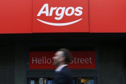 A pedestrian walks past an Argos store in London, Britain January 13, 2016. Sainsbury's, Britain's second-biggest supermarket, has agreed to buy Argos-owner Home Retail for 1.3 billion pounds ($1.87 billion) to boost its online credentials and expand beyond the cut-throat food sector. Home Retail, which said in January it had rejected an earlier undisclosed offer from Sainsbury's, said it was now willing to recommend a bid which, including a proposed capital return, implied a value of around 161.3 pence per Home Retail share.REUTERS/Stefan Wermuth