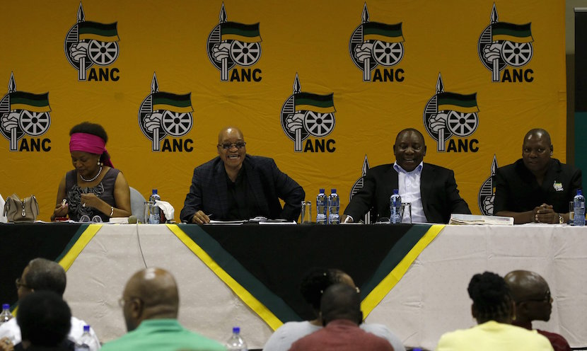 South Africa's President and African National Congress (ANC) party president Jacob Zuma, flanked by National Assembly Speaker Baleka Mbete, Deputy President Cyril Ramaphosa, ANC Treasury General Zweli Mkhize, reacts ahead of the party's National Executive Committee (NEC) three-day meeting in Pretoria, South Africa March 18, 2016. Picture taken March 18, 2016. REUTERS/Siphiwe Sibeko