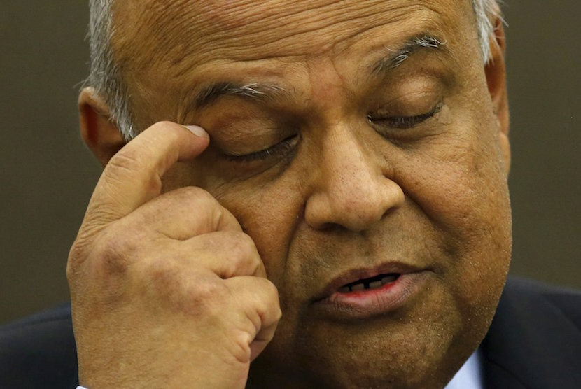 South African Finance Minister Pravin Gordhan reacts during a media briefing in Sandton near Johannesburg,March 14, 2016. Gordhan said on Monday he had constructive discussions with ratings agencies on a roadshow in London and the United States last week as Pretoria tries to fend off downgrades amid weak economic growth. REUTERS/Siphiwe Sibeko