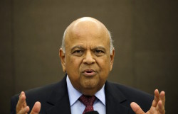 South African Finance Minister Pravin Gordhan gestures during a media briefing in Sandton near Johannesburg, March 14, 2016. Gordhan said on Monday he had constructive discussions with ratings agencies on a roadshow in London and the United States last week as Pretoria tries to fend off downgrades amid weak economic growth. REUTERS/Siphiwe Sibeko