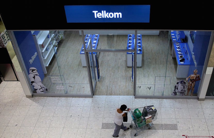 A shopper walks past a Telkom shop at a mall in Johannesburg February 26, 2016. REUTERS/Siphiwe Sibeko